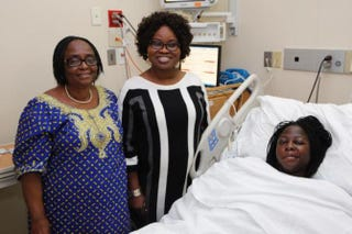 Alfolake Alao (center), 58, is a nurse at Woodhull Hospital and helped her daughter-in-law Temitope Alao deliver triplets. Alao traveled to New York with her mom, Adejoke Ogunrinde (left).KEVIN C. DOWNS/NEW YORK DAILY NEWS