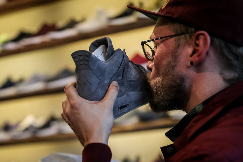 New KAWS x Air Jordan 4s buyer kisses his sneaker during the sale at Overkill store March 31, 2017, in Berlin. (Maja Hitij/Getty Images)