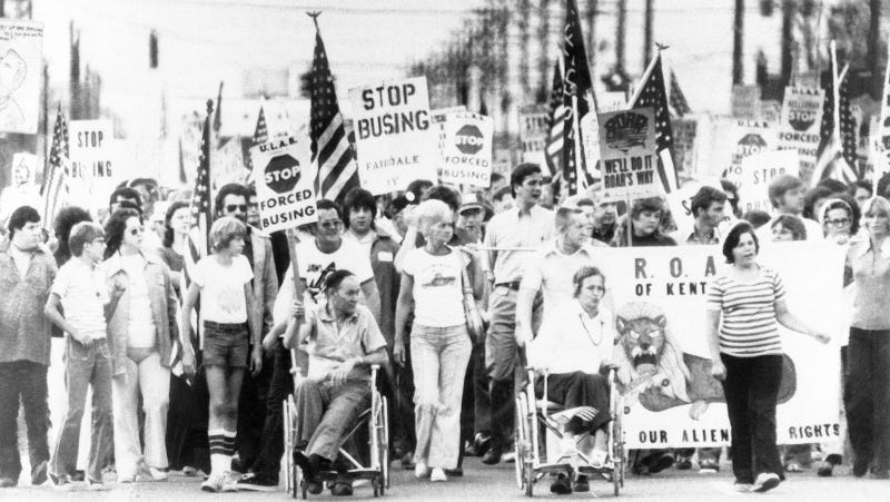 Protestors in Jefferson County, KY march against court-ordered school desegregation busing on August 31, 1976. Image via AP Photo.