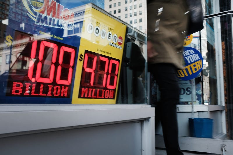 A Brooklyn convenience store advertises the Mega Millions lottery on October 19, 2018 in the Brooklyn borough of New York City.