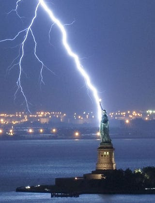 Illustration for article titled The Statue of Liberty Hit By Lightning