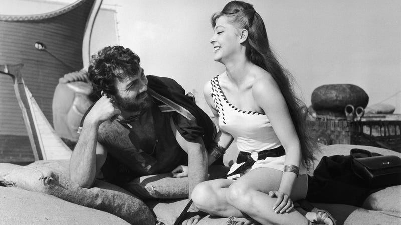 """Well-known barbarian Jack Palance and Melody O'Brien enjoy a laugh while filming the documentary """"Revak the Rebel."""" Photo credit: Jim Pringle/AP"""