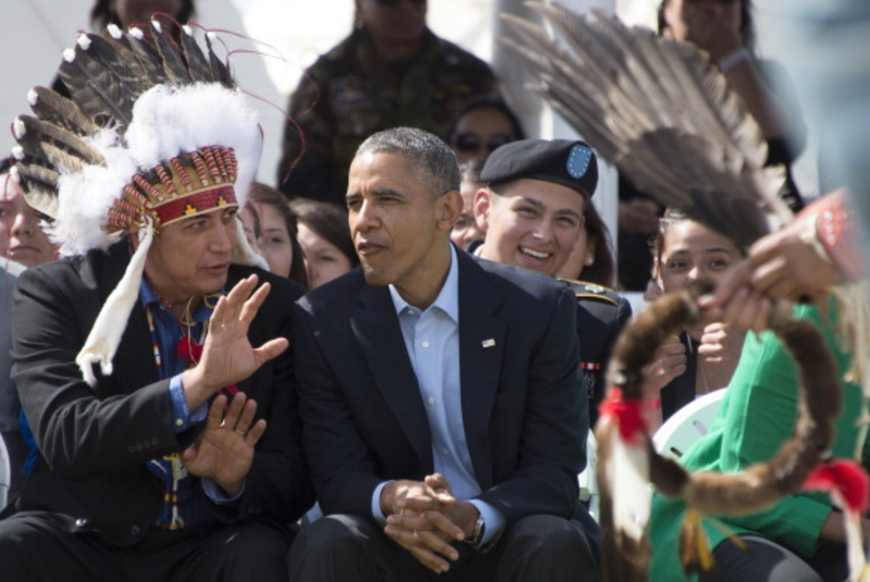 President Barack Obama (center) talks with Chairman of the Standing Rock Sioux Tribal Council David Archambault II during the Cannon Ball Flag Day Celebration in Cannon Ball, N.D., on June 13, 2014.JIM WATSON/AFP/Getty Images