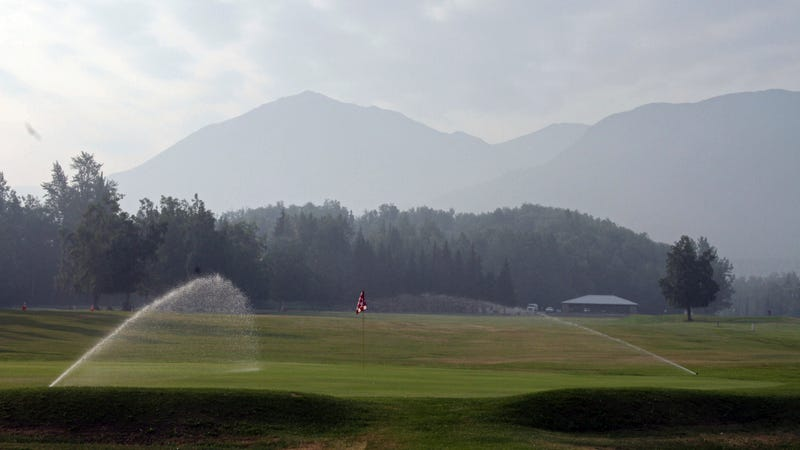 Smoky haze from a wildfire on Alaska's Kenai Peninsula obscures the view from an Anchorage golf course.