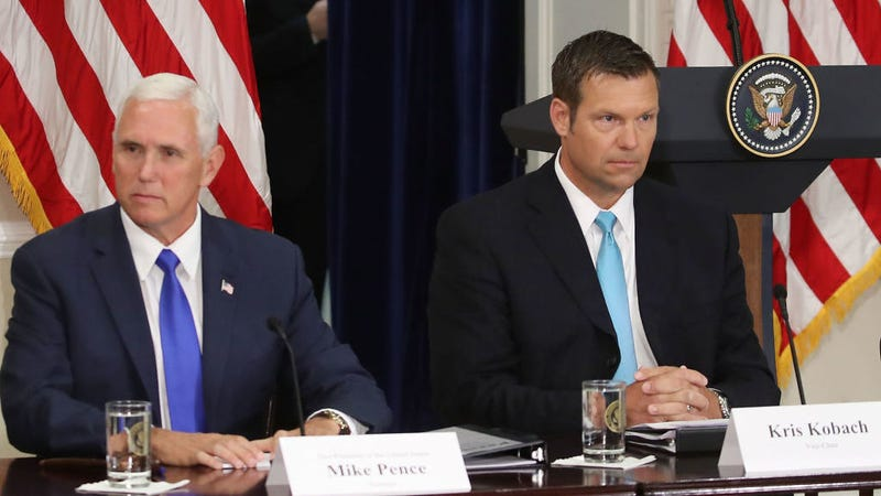 Kansas Secretary of State, Kris Kobach (R) and US Vice President Mike Pence, attend the first meeting of the Presidential Advisory Commission on Election Integrity in the Eisenhower Executive Office Building, on July 19, 2017 in Washington, DC. Photo: Getty