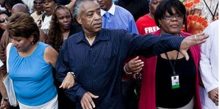 """The Rev. Al Sharpton leads a march in 2010 to commemorate Dr. King's """"I Have a Dream"""" speech (T.J. Kirkpatrick/Getty Images)"""