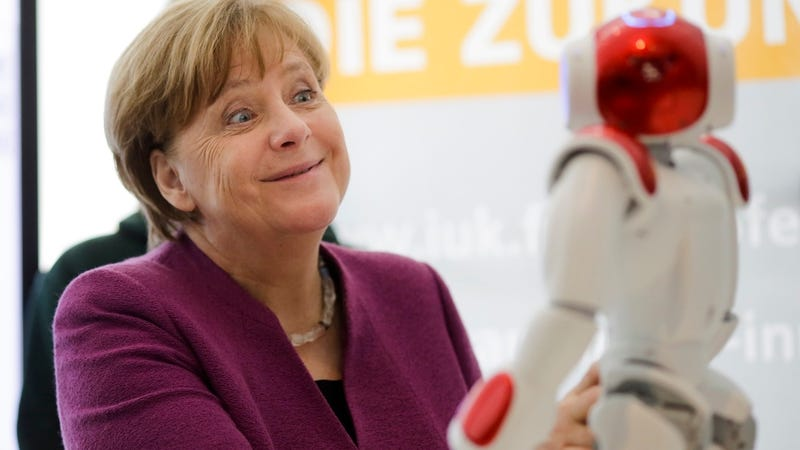 Illustration for article titled German Leader Angela Merkel Still Way Too Friendly With Robots
