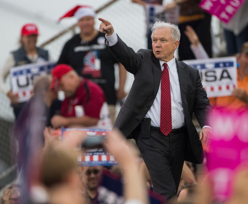 Sen. Jeff Sessions (R-Ala.), Donald Trump's pick for attorney general, joins the president-elect onstage during a thank-you rally  Dec. 17, 2016, in Mobile, Ala.      Mark Wallheiser/Getty Images