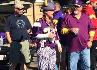 Illustration for article titled Tailgating Vikings Fan Wears Adrian Peterson Jersey And Wields Switch