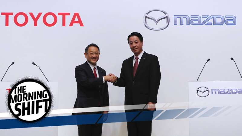 Toyota president Akio Toyoda and Mazda president Masamichi Kogai announce a $1.6-billion U.S. plant. Photo credit: AP Photo/Eugene Hoshiko