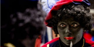 A woman has her face painted to become Zwarte Piet (Black Pete) in the Netherlands. (Robin Van Lonkhuijsen/AFP/Getty Images)