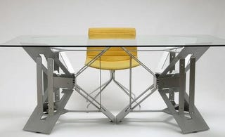 Illustration for article titled Futuristic Origami Desk Cut and Folded from a Single Sheet of Steel