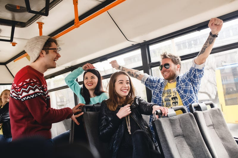 Pictured: You and your friends, enjoying the bus! Photo credit Shutterstock