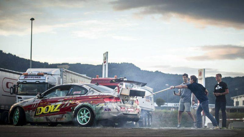 Illustration for article titled Watch Loeb And Webber Light A Giant Match With A Supercharged BMW