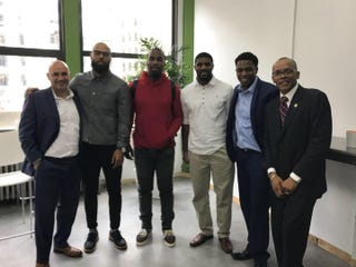 Flanked by local advocates in Detroit during a meeting are (second from left) DeAndre Levy, Anquan Boldin and Don Carey, former and current players for the Detroit Lions. (Angela LaChica)