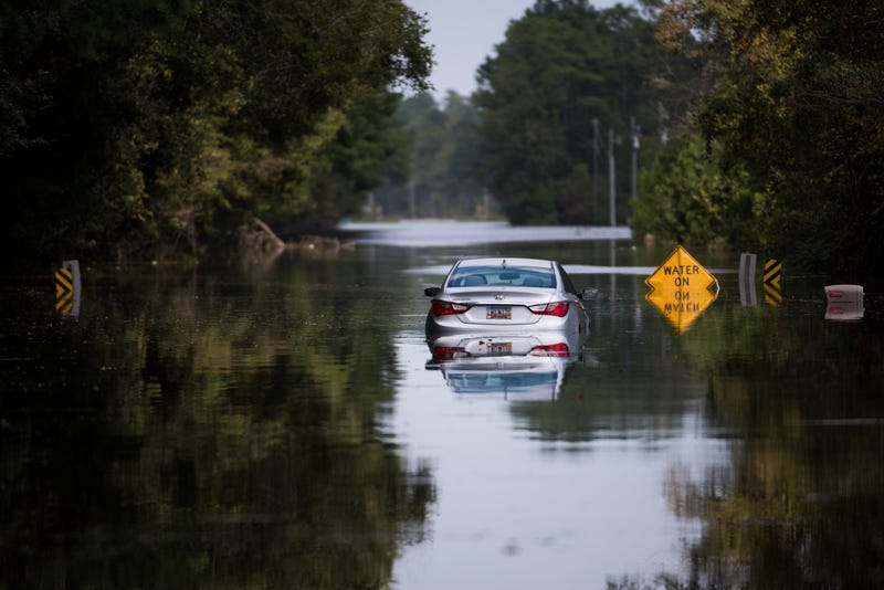 A disabled car is surrounded by floodwaters caused by Hurricane Florence near the Todd Swamp on September 21, 2018 in Longs, South Carolina. Floodwaters are expected to rise in the area in through the weekend.