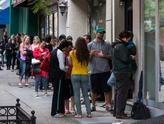 People wait in line to purchase a donut-croissant hybrid (known as a cronut) outside Dominique Ansel Bakery in New York.Andrew Burton/Getty Images