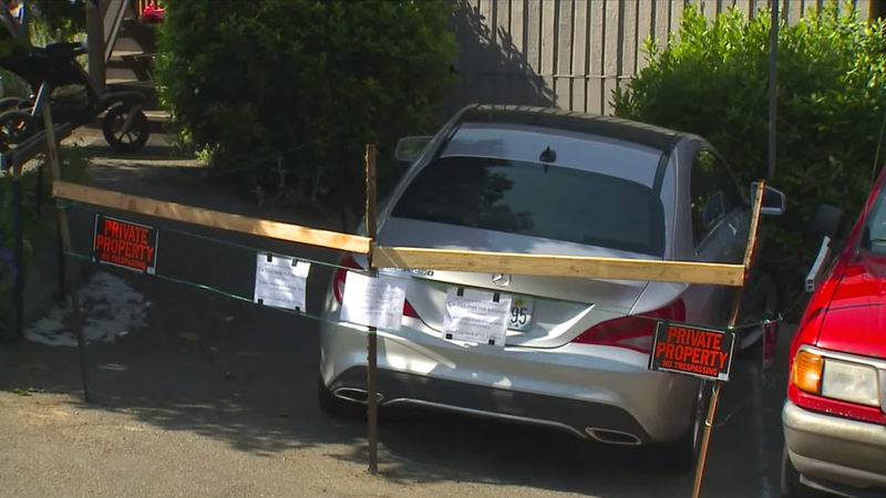 Illustration for article titled Car2stay: Frustrated Man Builds Fence Around Car2go Parked in His Driveway, Demands Fee