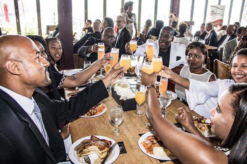 The New York Urban League Black & White Champagne Brunch participants raise a glass on Sept. 16, 2017. (Malik Yusef Cumbo/MYC Photographics)