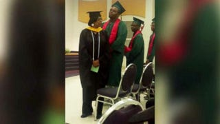 Michael Brown is seen standing with his peers for his high school graduation.ABC screenshot