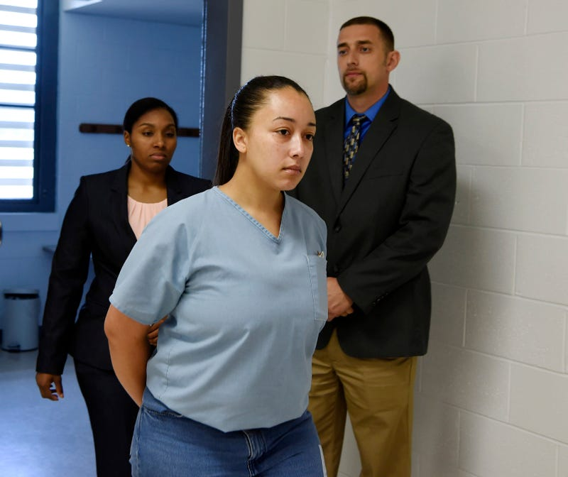 Cyntoia Brown, a woman serving a life sentence for killing a man when she was a 16-year-old prostitute, enters her clemency hearing Wednesday, May 23, 2018, at Tennessee Prison for Women in Nashville, Tenn.