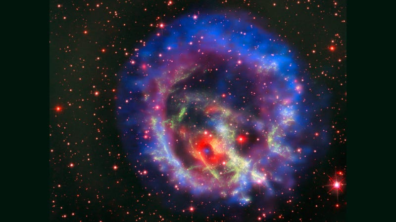 The remnants of a supernova explosion in a neighboring galaxy.