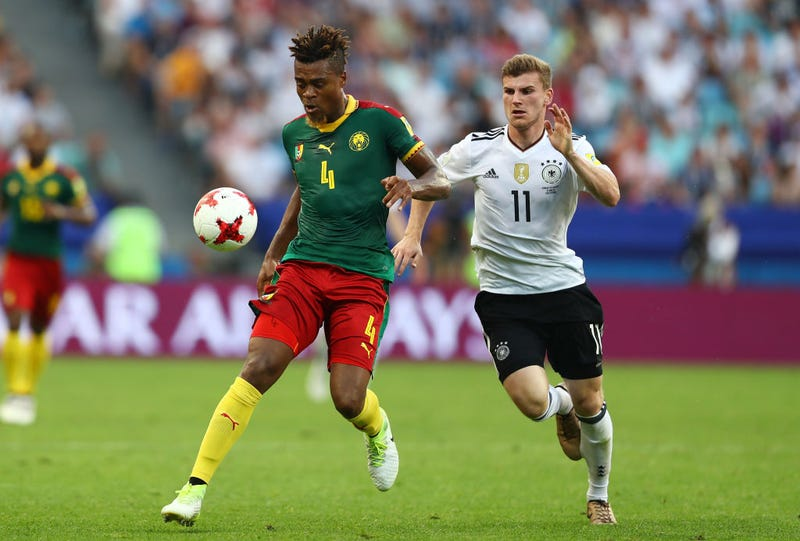 Adolphe Teikeu of Cameroon and Timo Werner of Germany battle for possession during the FIFA Confederations Cup Russia 2017 Group B match between Germany and Cameroon at Fisht Olympic Stadium on June 25, 2017, in Sochi, Russia.