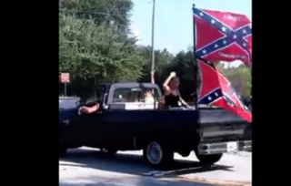 Screenshot captured by partygoers at an African-American family's birthday celebration appears to show members of Confederate-flag group Respect the Flag taunting those gathered as they left the scene. NBC News screenshot