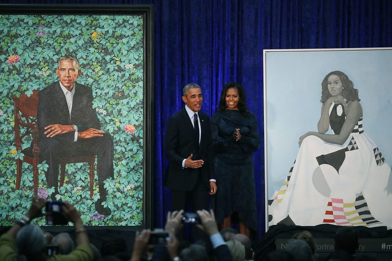 Former U.S. President Barack Obama and former first lady Michelle Obama stand next to their newly unveiled portraits during a ceremony at the Smithsonian's National Portrait Gallery, on Feb. 12, 2018, in Washington, D.C.