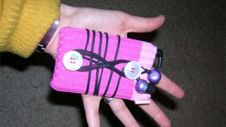 Illustration for article titled Add a Headphone Wrapper to Your iPod Case with Two Buttons