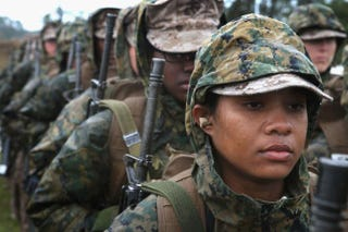 Marine recruit Christina Wauchope waits with other female recruits to fire on the rifle range during boot camp at MCRD Parris Island, S.C., on Feb. 25, 2013.SCOTT OLSON/GETTY IMAGES