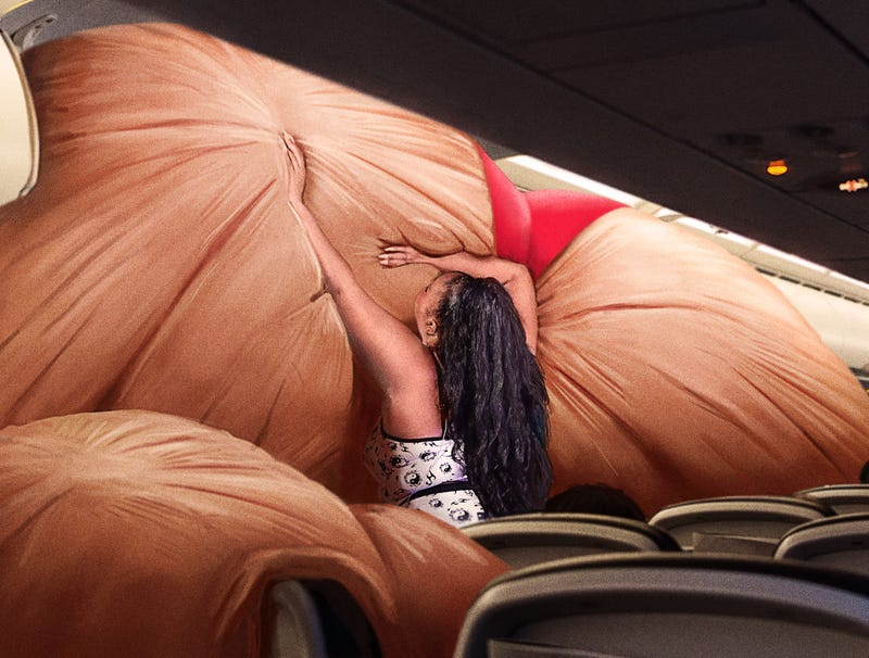 Illustration for article titled Flight Attendant Annoyed By Lizzo Attempting To Stuff Giant Inflatable Ass Into Overhead Compartment