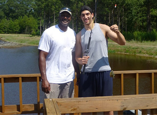 Illustration for article titled Karl Malone And Enes Kanter Caught A Tiny Fish