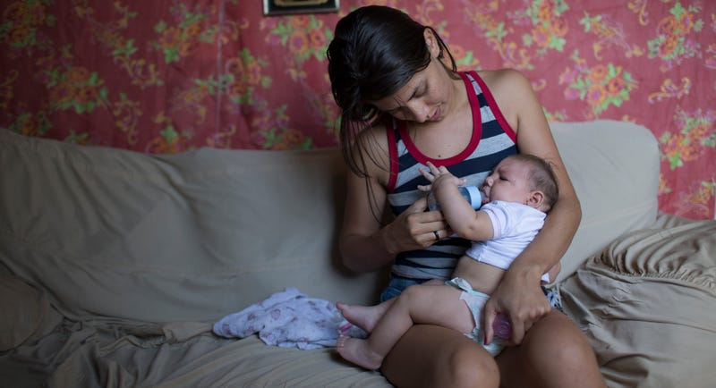 Angelica Pereira feeds her baby Luiza, who was born with microcephaly in Brazil on 6-February 2016. (AP Photo/Felipe Dana)