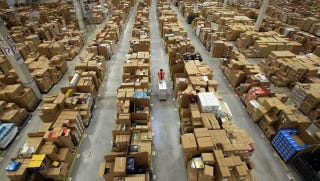 Illustration for article titled The Inside of an Amazon Warehouse is a Terrifying Sight