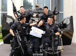 Illustration for article titled Chinese SWAT Team Recruits With Smiles And Crossbows