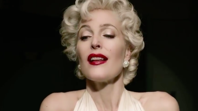 Gillian Anderson as Media, depicting herself as Marilyn Monroe.