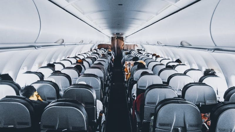 How to Lift the Aisle Armrest on an Airplane