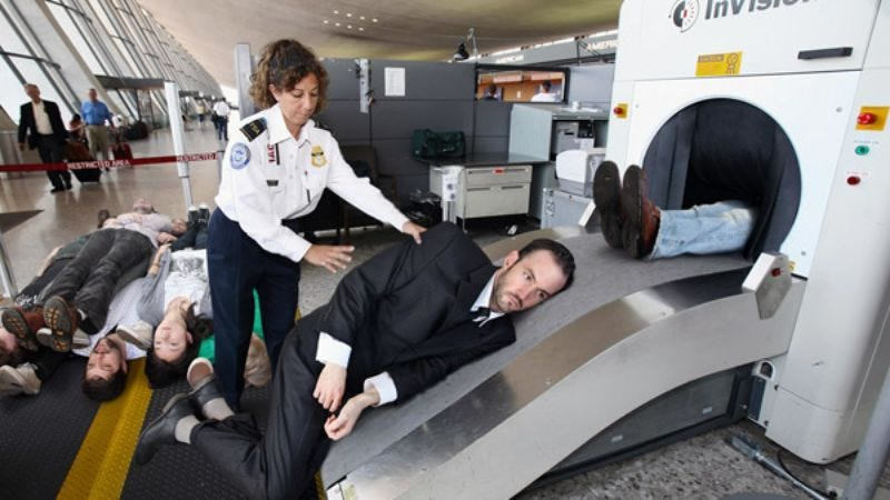 A TSA officer loads in the tall stock for a routine explosives scan.