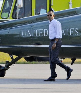 Obama leaves for vacation amid controversy. (Getty)