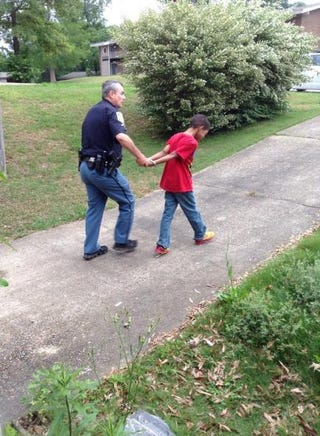 """Chiquita Hill's son being """"arrested"""" by law enforcementFacebook/Jada Powell"""