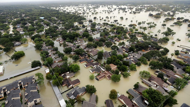 Water from Addicks Reservoir flows into neighborhoods as floodwaters from Tropical Storm Harvey rise August, 29, 2017, in Houston. (AP Photo/David J. Phillip)