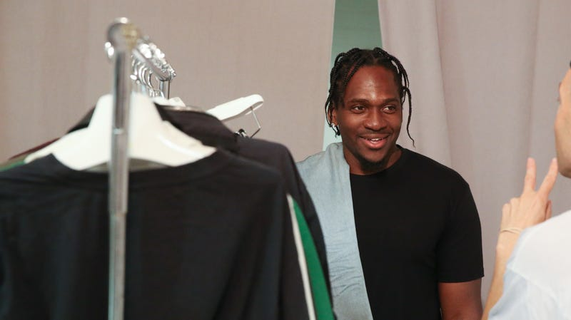 Pusha T looks over outfits backstage at the John Elliott fashion presentation during New York Fashion Week: Men's S/S 2017 on July 13, 2016 in New York City.