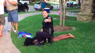 Video footage showing a McKinney, Texas, police officer sitting on top of a black teenage girl attending a pool party June 5, 2015Youtube Screenshot