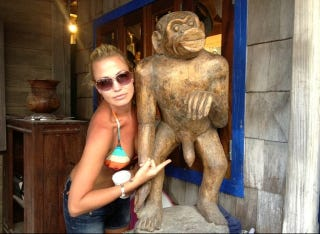 Illustration for article titled Michelle Beadle Tweeted A Photo Of Herself In A Bikini Top While Pointing At A Large Penis On A Monkey Statue
