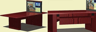 Illustration for article titled Plasma-Lift Conference Table Does a Leno-Like Sprout of a 42-Inch Plasma Display