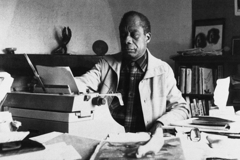 American writer James Baldwin poses in front of his typewriter in his house in St. Paul de Vence, France, on March 15, 1983. (AP Images/Photo Pressenia)