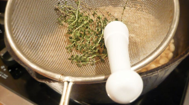 Illustration for article titled Get Fresh Herbs Off the Stems With a Mesh Strainer