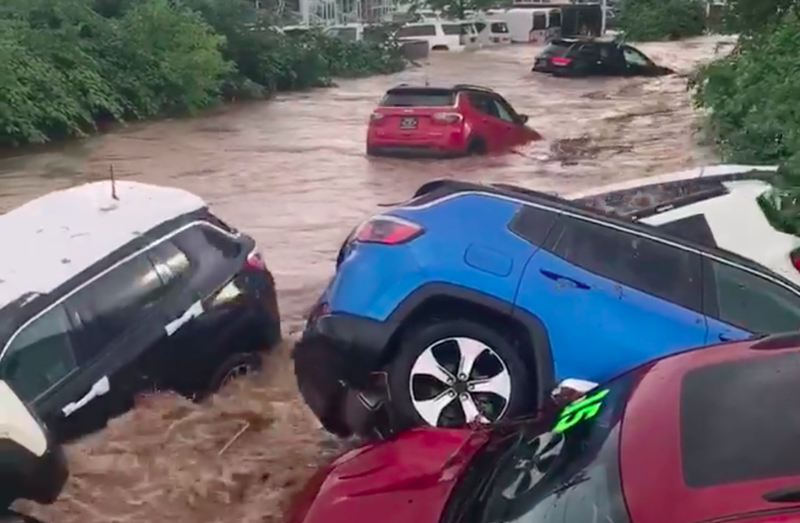 Illustration for article titled Watch a New Jersey Dealership's Jeeps and Rams Get Swept Away by a Raging Flood
