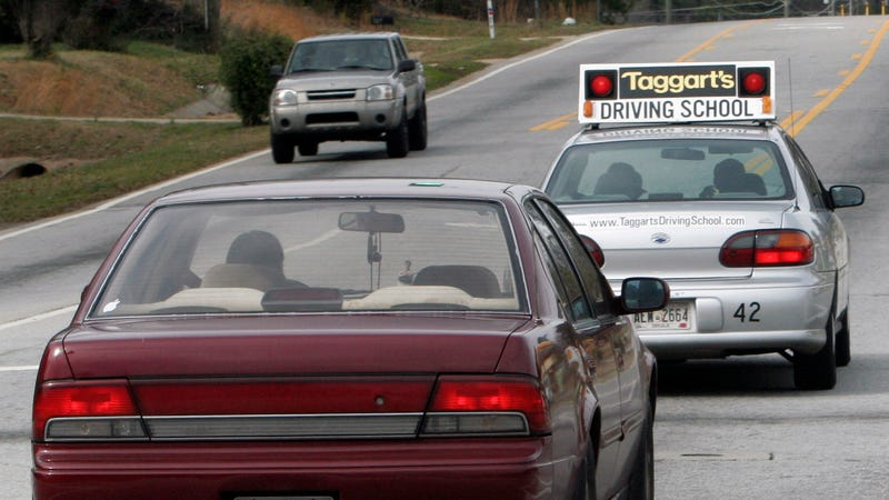 A driving school vehicle driven by a student driver moves through traffic on a highway in Tucker, Ga. Wednesday, Jan. 24, 2007. Image credit: Gene Blythe/AP Images
